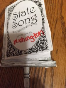 The kids had to look up the state song of Washington, and write the lyrics on the inside of this songbook.