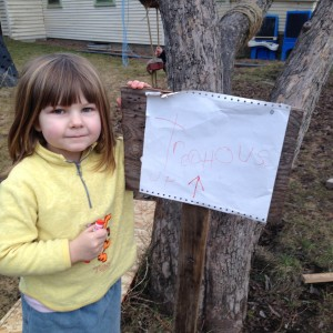 """Ellie, Jeffrey and Sydney are working on building a tree house in the apple tree.  Here is the sign Ellie worked on.  It says, """"Treehouse Up"""" with an arrow pointing up."""