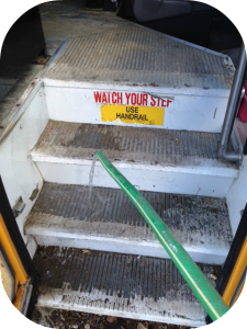 Cleaning the stairs on a family bus.