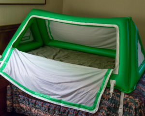 A portable enclosed bed made traveling with a child with Angelman Syndrome much easier!