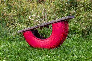 Upcycled old car tire seesaw