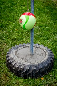 tetherball pole set in an old car tire